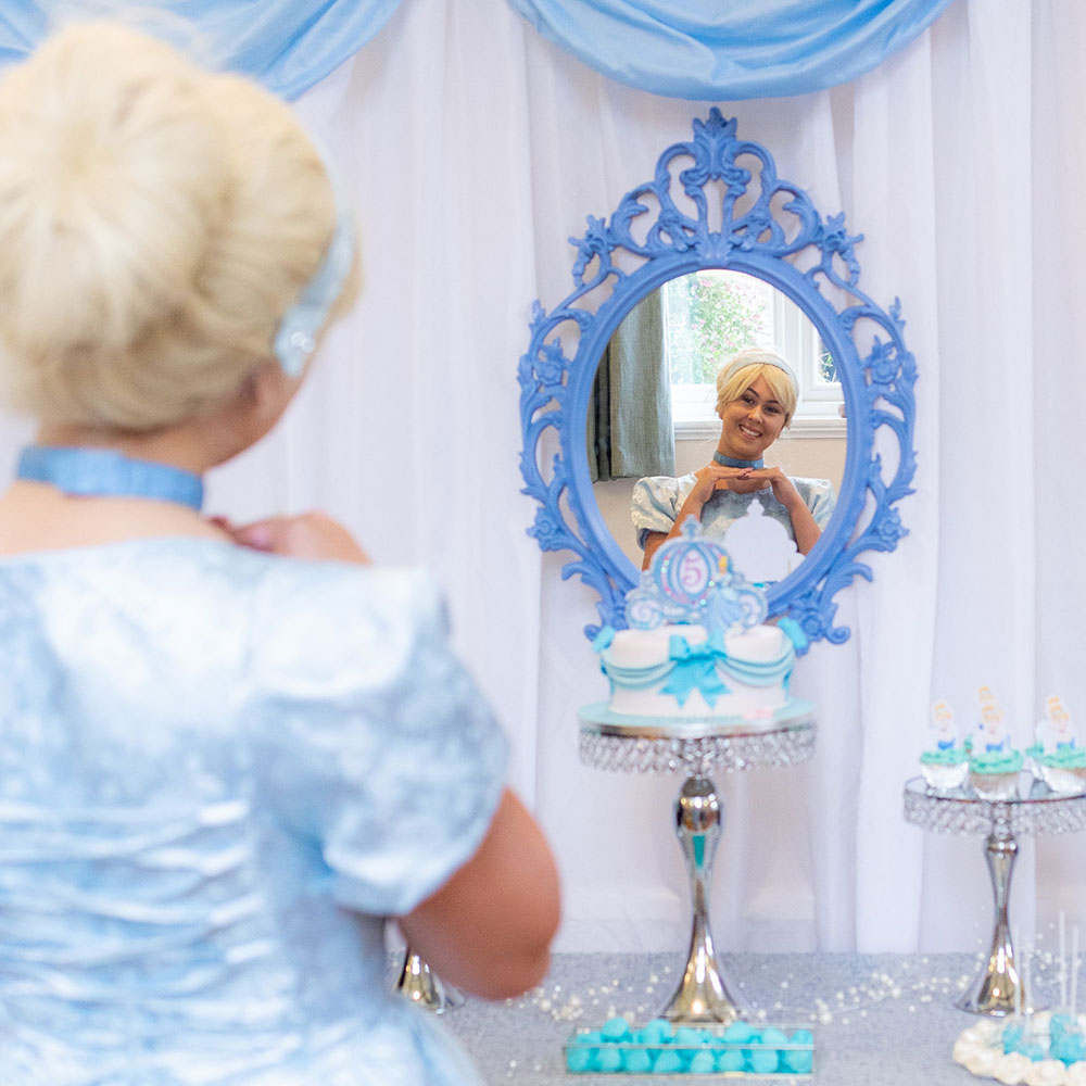 Cinderella looking into a mirror