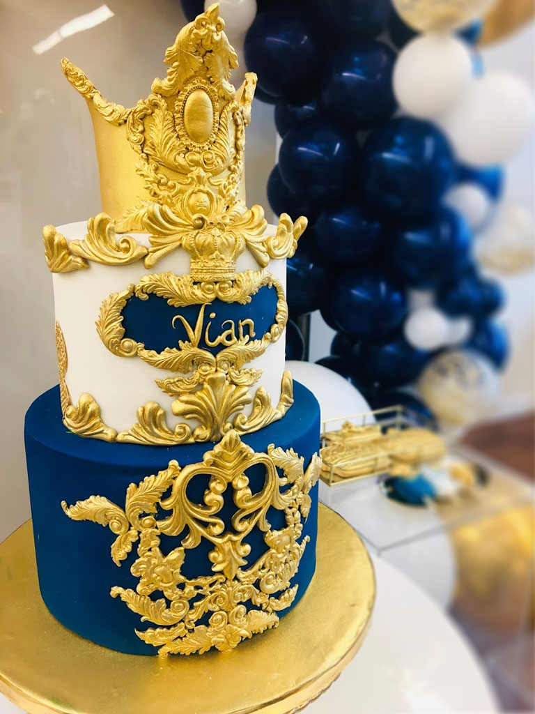 Blue, gold and white prince themed cake