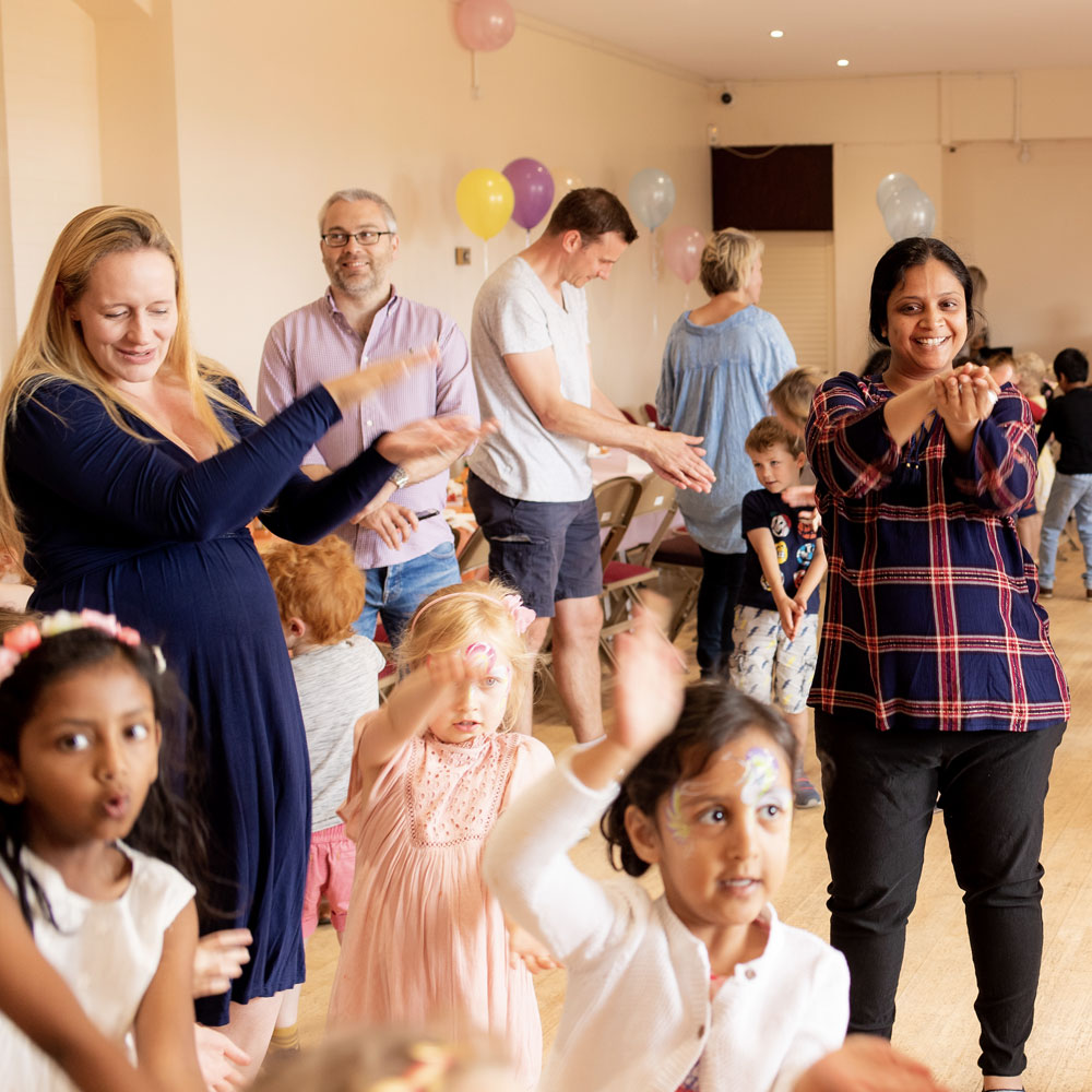 Parent and children enjoying a child's birthday party