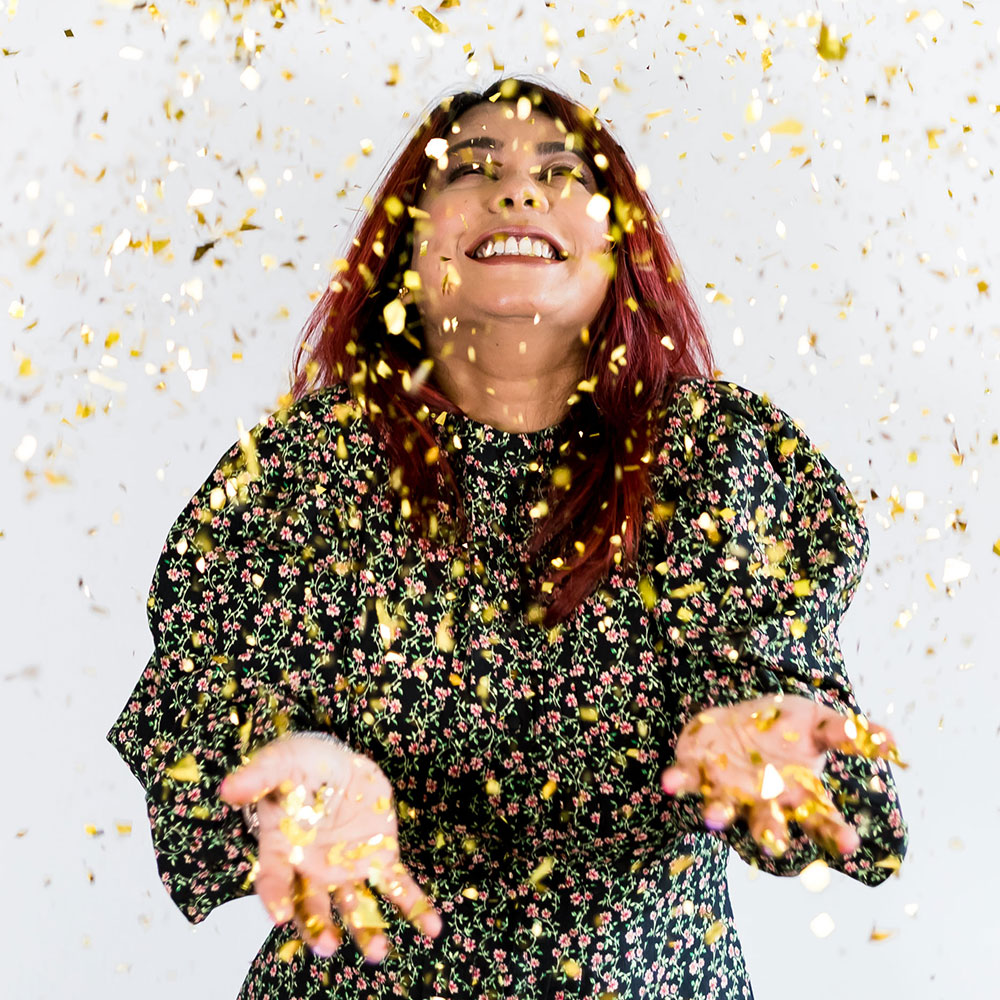 Children's parties from Party Genie - Nalini in a shower of golden confetti