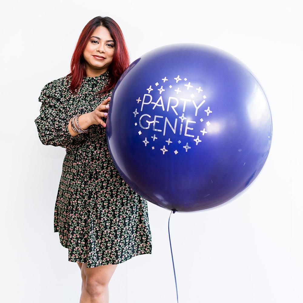 Nalini holding party genie balloon